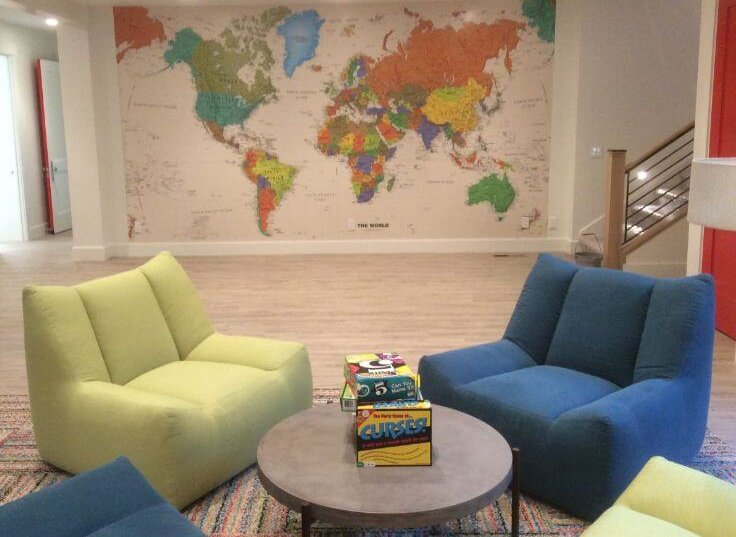 basement room with large world map